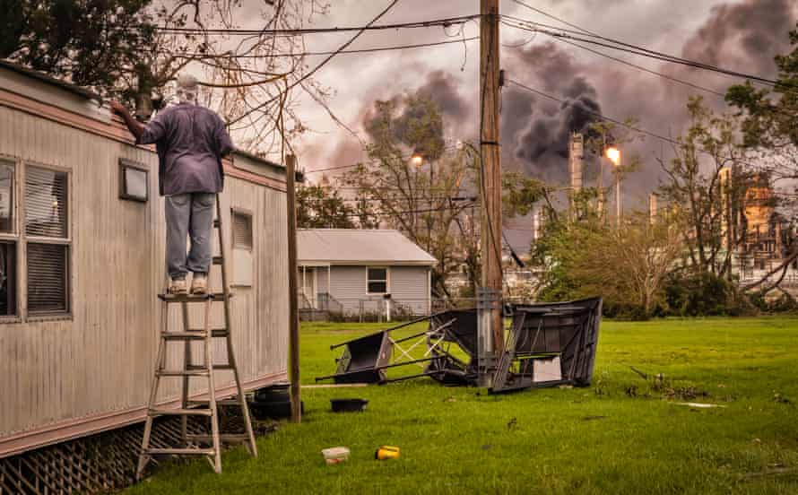 A resident inspects the damage to his home next to Shell's refinery and chemical plant on 31 August.