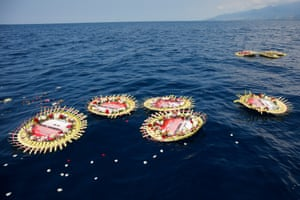 Bali, IndonesiaMourners lay wreaths with names of the 53 crew members on board the sunk Indonesian Navy submarine KRI Nanggala in the sea near Labuhan Lalang,