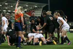 New Zealand's Kendra Cockseage celebrates scoring a try.