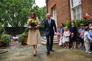 First Lady Melania Trumpand Philip May, husband of Britain's Prime Minister Theresa May, attend a garden party at Downing Street