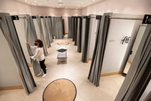 John Lewis staff getting fitting rooms ready at their White City store ahead of reopening on April 12. A host of retailers have confirmed reopening plans for next Monday as shoppers look forward to a return to bricks and mortar shopping after more than three months.