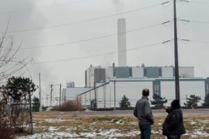 Activists Mike Ewall, left, and Zulene Mayfield stand in front of the Covanta incinerator in Chester, Pennsylvania. The incinerator brings in garbage from New York, Ohio and other states.