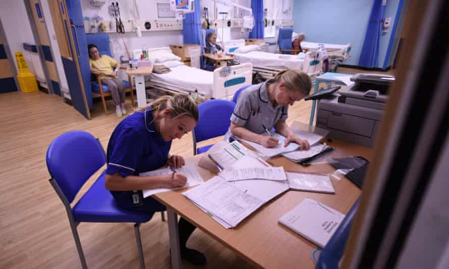 Members of clinical staff complete paperwork in the Accident and Emergency department of the 'Royal Albert Edward Infirmary' in Wigan, north west England.
