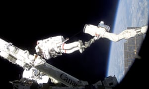 Ready to climb back down to earth now? An astronaut works on a space station