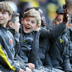 Watford's under-8s notice themselves on the big screen before kick-off