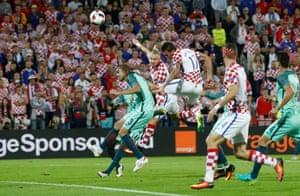 Croatia's Domagoj Vida heads at goal.