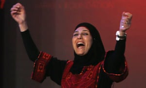 Hanan al-Hroub, a Palestinian primary school teacher, reacts after Pope Francis named her recipient of the second annual Global Teacher prize.