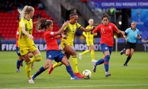 Madelen Janogy dribbles past Chile's Javiera Toro on her way to scoring a wonderful solo goal for Sweden.