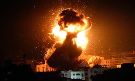 A ball of fire is seen above Gaza City after an Israeli airstrike on a building believed to house the offices of the Hamas leader Ismail Haniyeh.