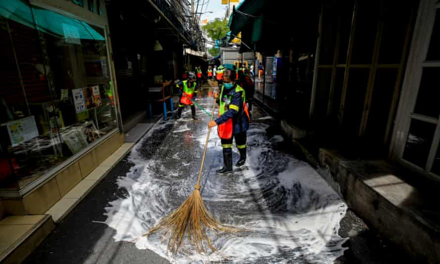 A Bangkok market is cleaned after a worker tested positive