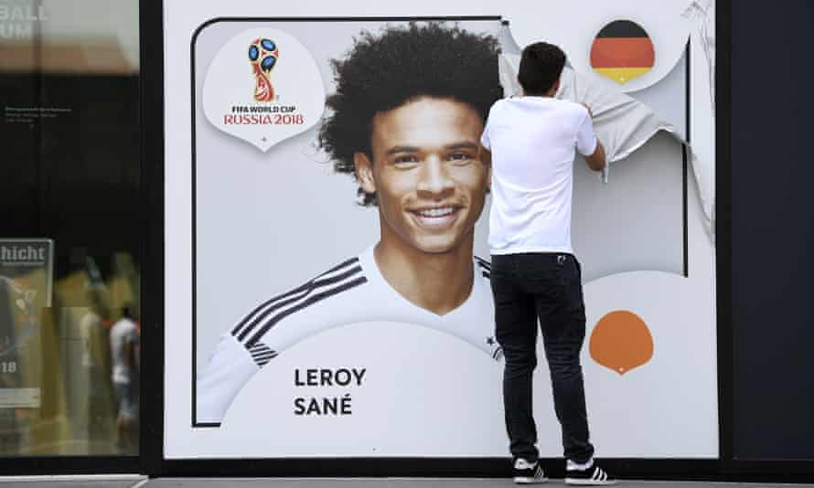A promotional World Cup poster of Leroy Sane is taken off the wall of the German football museum in Dortmund, Germany.