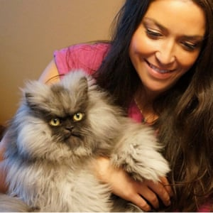 Colonel Meow with his owner Anne Marie Avey.