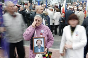 A woman holds a portrait of an emergency worker during the unveiling of a memorial by the sculptor Sergei Isakov in Rostov-on-Don, Russia. It honours those involved in the immediate response to the nuclear disaster