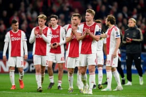 Ajax's players applaud their fans after the final whistle.