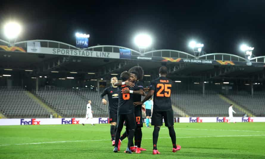 Juan Mata is congratulated after scoring Manchester United's third goal at Lask Linz in a Europa League last-16 first leg game played in front of empty stands