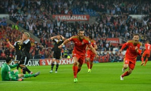 Aaron Ramsey, right, celebrates Gareth Bale's goal for Wales against Belgium in June's Euro 2016 qualifier