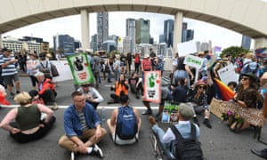 Activists from Extinction Rebellion (XR) take over the William Jolly Bridge during protests in Brisbane, 11 October 2019.