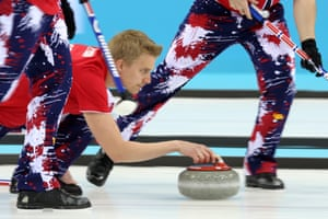 Vad Haavard Petersson of Norway delivers a stone during the tie-breaker match between Norway and Great Britain