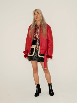 Red biker jacket Urban Outfitters, red yellow black white patterned shirt, Stories, black vinyl shirt with fur edged pockets Monki, black zip front ankle boots Mango