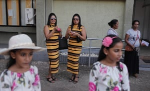 Colombo, Sri Lanka. People participate in a record attempt for the largest gathering of twins. Sri Lankan Twins, which organised the event and held it in a sports stadium, claims to represent 28,000 twins and multiples
