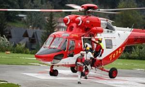 Mountain rescue team members board a helicopter in Zakopane, Poland