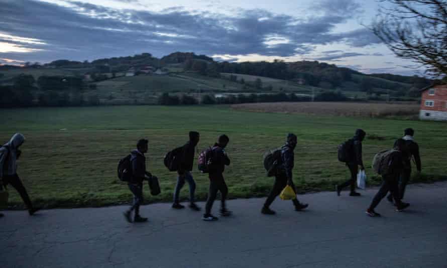 Migrants gather before trying to cross the Bosnia-Croatia border near Velika Kladusa.