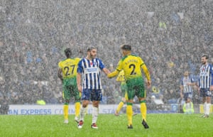Neal Maupay of Brighton and Max Aarons of Norwich shake hands in the torrential rain at the AMEX Community Stadium. The Seagulls secure the points, winning 2-0, only the second time they have won three consecutive home games in the Premier League (also in March 2018 under Chris Hughton).