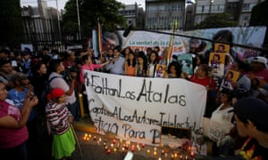 Demonstrators gather outside a court after the trial of the men charged with the murder of indigenous environmental activist Berta Cáceres, in Tegucigalpa.