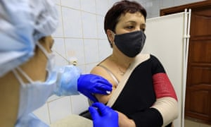 A volunteer receives EpiVacCorona vaccine injections against COVID-19 in Russia