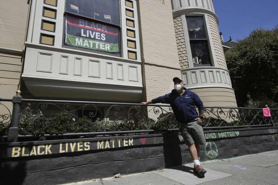 James Juanillo poses outside of his home in San Francisco, Sunday.