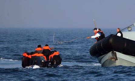 Border Force officers intercept a dinghy carrying 20 Syrian migrants in the Channel on 10 August.