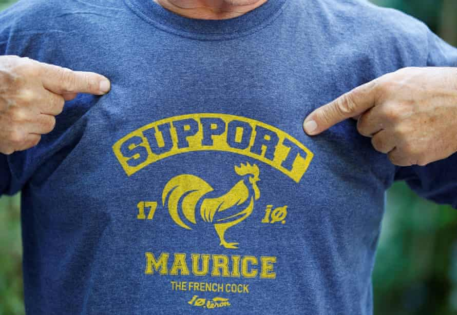 A man wears a T-shirt in support of Maurice, whose loud crows landed him in court accused of noise pollution.