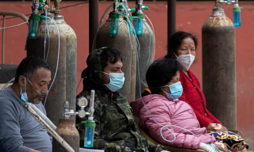 Patients receive oxygen outside a hospital in Kathmandu