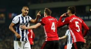 West Bromwich Albion's Salomon Rondón attempts to get his point across to Manchester United's Marcos Rojo and Phil Jones.