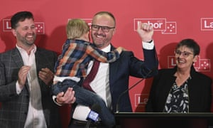 Chief minister Andrew Barr holds his nephew as he celebrates Labor winning its sixth successive election in the ACT.