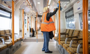 A TFL worker cleaning a London Overground train, 20 March 2020