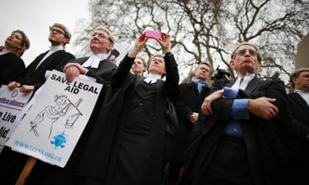 People at a protest against legal aid cuts