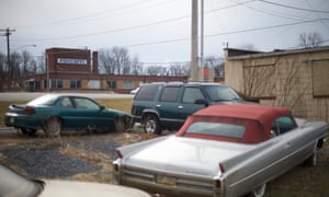 Old cars parked across the street from the Foxconn office in Harrisburg, Pennsylvania, in 2017. Foxconn said it would build a $30m factory here in 2013, but it never happened.