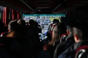 Police escort a bus transporting French citizens after leaving The Vacanciel Holiday Resort in Carry-le-Rouet, near Marseille, southern France on early February 14, 2020, where they spent 14 days in quarantine after their repatriation from Wuhan