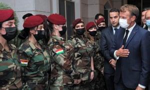 French president Emmanuel Macron (R) meets with female members of the Kurdish Peshmerga in Arbil, the capital of Iraq's northern autonomous Kurdish region, on 29 August.