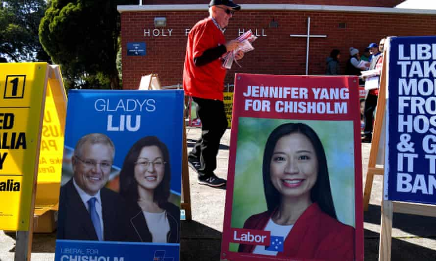 Placards outside a polling station in the outer Melbourne electorate of Chisholm where fake AEC-style signs in Mandarin told voters to give their first preference to the Liberal party.