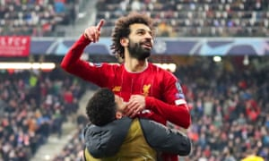 Mohamed Salah celebrates scoring Liverpool's second goal with substitute Alex Oxlade-Chamberlain.