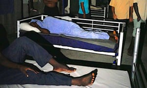 Men sleep on beds inside the decommissioned Manus Island detention centre in Papua New Guinea.