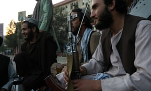 Taliban soldiers talk to each other, in Kabul, Afghanistan, earlier today.
