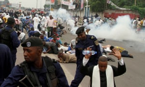 Riot police fire teargas to disperse Catholic priest and demonstrators during a protest against President Joseph Kabila earlier this year.