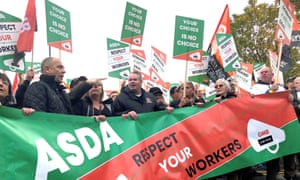 Asda workers marching through Leeds to the company's headquarters in opposition to the new contract.