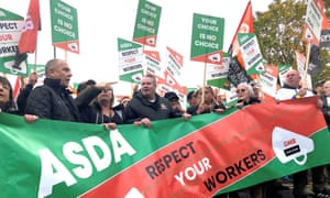Asda workers march through Leeds
