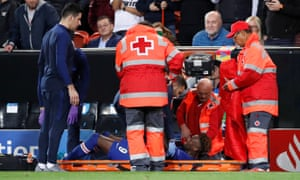 Chelsea's Tammy Abraham receives medical attention after sustaining an injury.