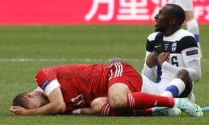 Roman Zobnin of Russia reacts after a foul by Glen Kamara of Finland (right).