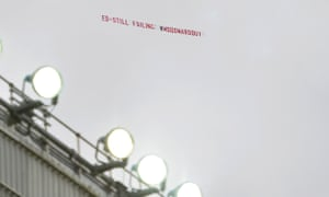 A plane carries a message over Old Trafford in October.